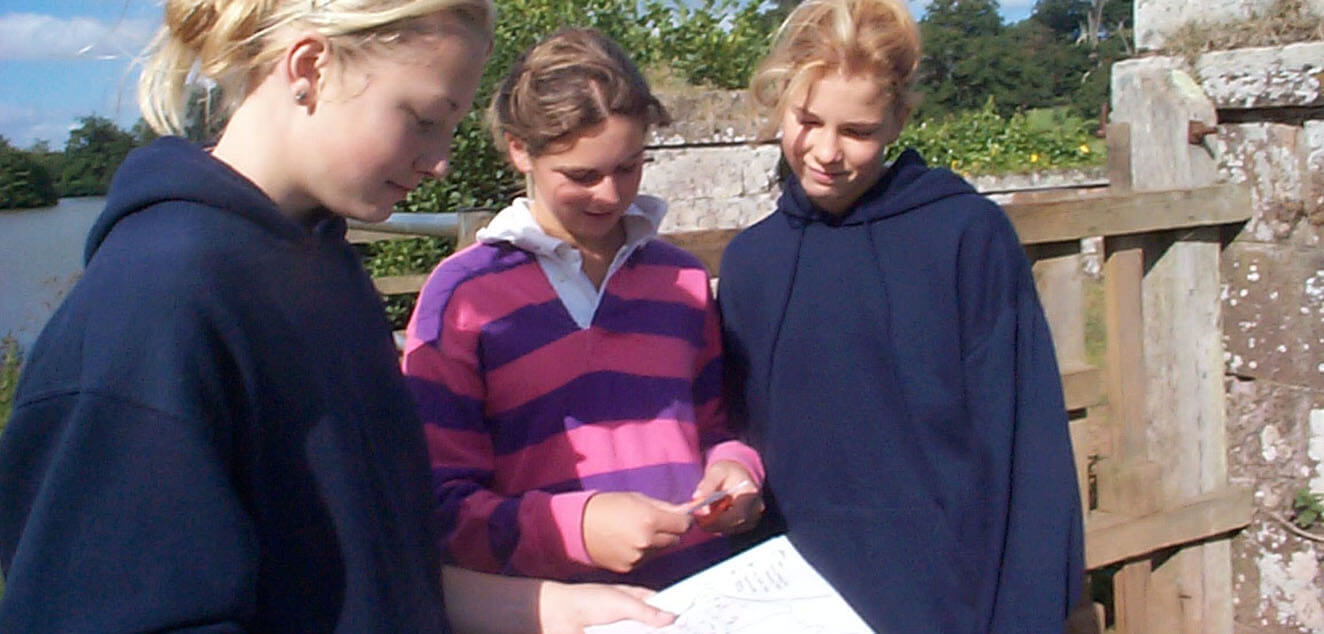 girls looking at a map
